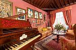 Piano, carpets, paintings