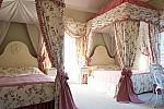 Two four poster beds