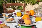 Fresh fruit and pastries breakfast