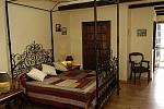 Large bedroom with iron bedstead