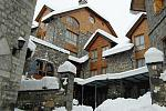Small mountain hotel, winter holiday