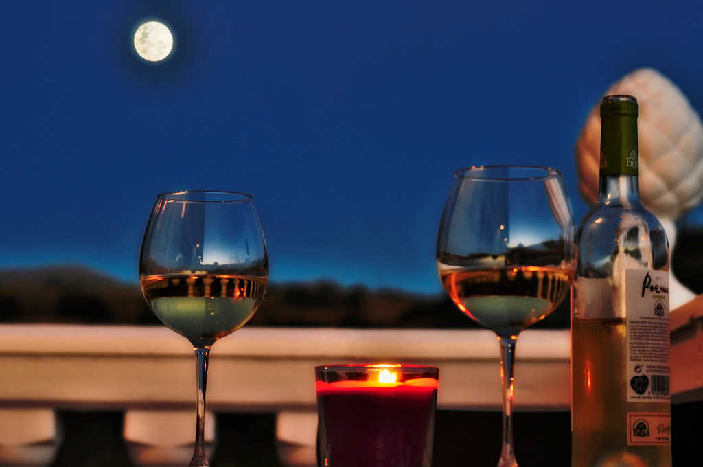Sipping wine by the light of the moon